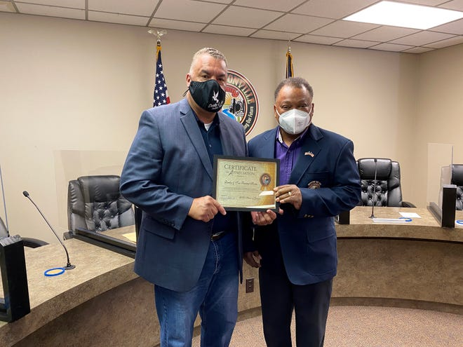 Charleston Demby of Demby and Son Funeral Home receives a Spirit of Giving award from Donaldsonville Mayor Leroy Sullivan Jan. 1