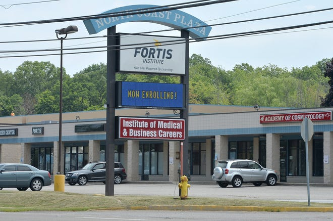 In this July 2018 file photo, the sign for Fortis Institute and the Institute of Medical & Business Careers are shown along West Ridge Road in front of the Fairview Township campus that both trade and career schools shared. Fortis has since closed its Erie campus. The Northern Pennsylvania Regional College plans to occupy 10 classrooms and space that can accommodate five to seven labs for its own technical center.