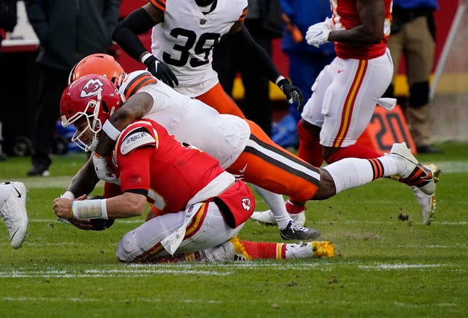 Kansas City Chiefs quarterback Patrick Mahomes (15) is brought down by Cleveland Browns linebacker Mack Wilson (51) in Sunday's playoff game at Arrowhead Stadium. Mahomes suffered a concussion on the play but the Chiefs hung on for a 22-17 win.