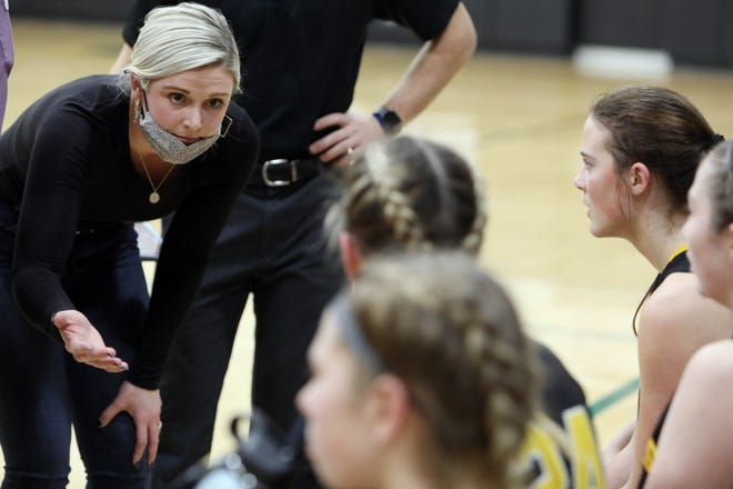 Central Lee High School's assistant coach Taylor Hickey, talks with players during a timeout at their game against West Burlington High School, Friday Jan. 15, 2021 at West Burlington.