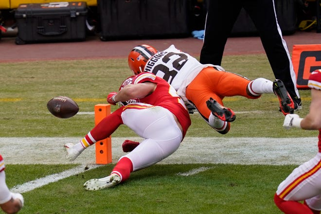Cleveland Browns wide receiver Rashard Higgins (82) fumbles the ball over Kansas City Chiefs safety Daniel Sorensen at the goal line during the first half of Sunday's playoff game in Kansas City.