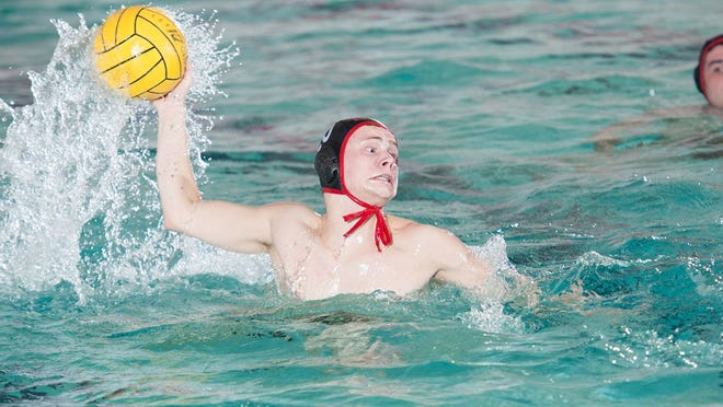 Monmouth College's Joseph Addison looks to move the ball in a men's water polo match in 2019. [MONMOUTH COLLEGE PHOTO]