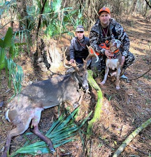 This deer was shot in Livingston Parish. The misplaced shot was in the back leg, and the buck managed to get 430 yards before Oakley found him. Pictured (L to R) oldest son Braidon, Chris and dog Oakley.