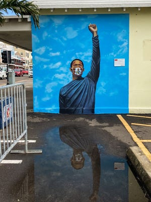 A mural of former Hendersonville High multi-sport standout Grant Rivers is seen on a building in Hamilton, Bermuda.