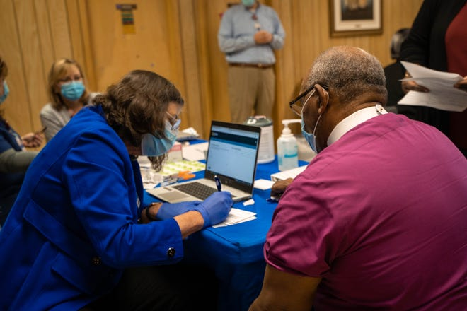 AdventHealth Hendersonville partnered with a historic African American church, Greater New Zion Baptist Church in Fletcher, for a COVID-19 vaccine clinic on Martin Luther King Jr. Day. Shown is Bishop Lionel Smith receiving his vaccine.