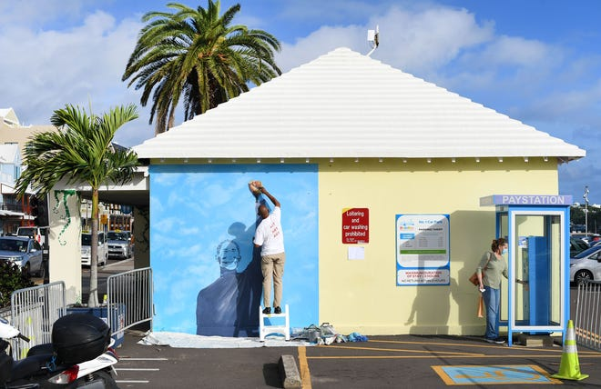 This is the first installation for the Peaceful Art Protests Mural, painted by Dennis Joaquin on Front Street in Hamilton, Bermuda. The mural he is painting is of former Hendersonville High multi-sport standout Grant Rivers.