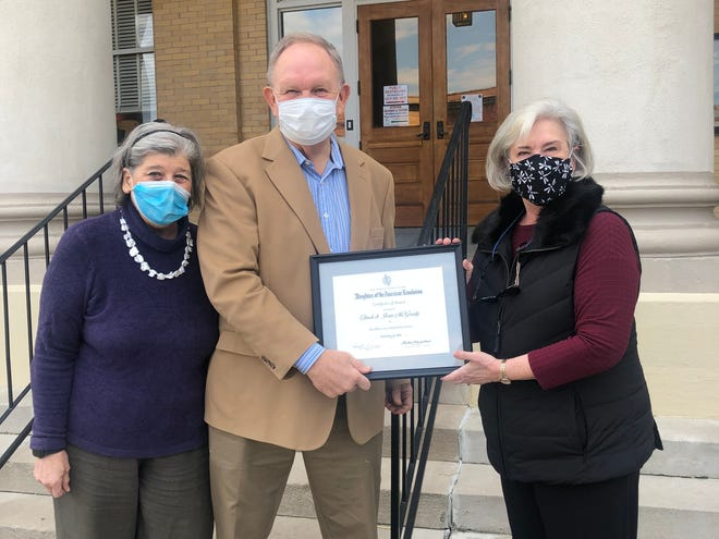 The Abraham Kuykendall Daughters of the American Revolution presented the McGrady family with the Excellence in Community Service Award. Shown are Penny Summey, right, regent with the Abraham Kuykendall Daughters of the American Revolution, presenting the award to Chuck and Jean McGrady.