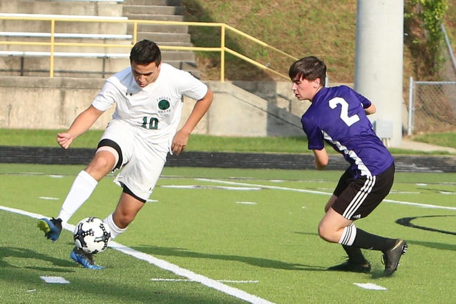 East Henderson's Aldo Montano (10) gets control of the ball in front of North Henderson's Dominik Pross during last year's match at North.