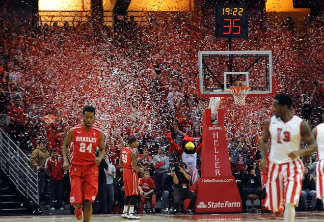 In this 2014 file photo, confetti fills the air over one section of Redbird Arena as Illinois State scores its first points against Bradley in Normal. The rivalry game on Wednesday will be nothing like this as no fans are permitted in the arena because of COVID-19 restrictions.