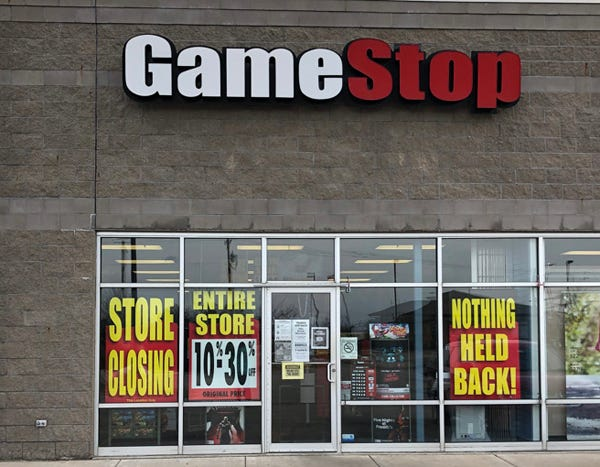 """Store closing"" and discount signs are seen in the window of the Game Stop store located at 1710 E. Jackson St., unit A, Macomb. The store is one among hundreds of Game Stops which are closing across the country."
