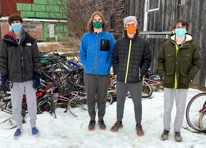 Current and former Hamilton Central School students, from left, Craig Arquiett, Sam Larson, TJ Larson and Owen Arquiett pitched in recently to help at the Community Bikes outreach in Hamilton. The four volunteered an afternoon to load, unload and organize bikes at the organization's workshop at Milford Street. Community Bikes continues to collect and refurbish donated bicycles in anticipation of resuming placements of bikes with low income families throughout Madison County beginning this spring.