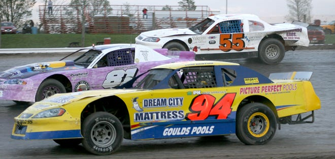 Pro Stock drivers Tom Denton (94), Bret Belden (81) and Dave Meeks (55m) round the second turn during a May race at Utica-Rome Speedway last year.
