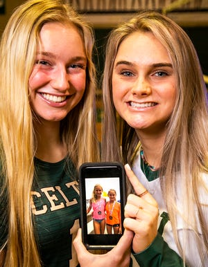 Trinity Catholic's Amelia Fitzpatrick and Forest's Emma Truluck are this year's Ocala Star-Banner Co-Volleyball Players of the Year. They share a picture of themselves when they were 9 and 10 playing beach volleyball together.