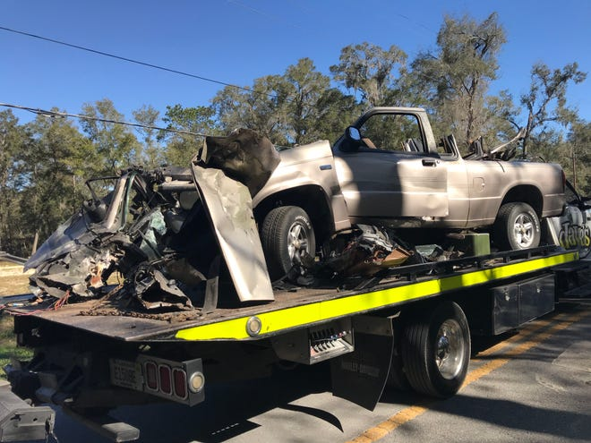 This pickup truck struck the back of a garbage truck early Tuesday near Dunnellon. The two passengers were killed and the driver is hospitalized in critical condition.