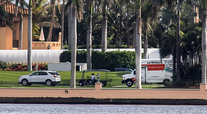 A U-Haul truck is seen on the grounds of Mar-a-Lago on Tuesday. President Donald Trump is expected in Palm Beach on Wednesday as his one-term presidency ends.