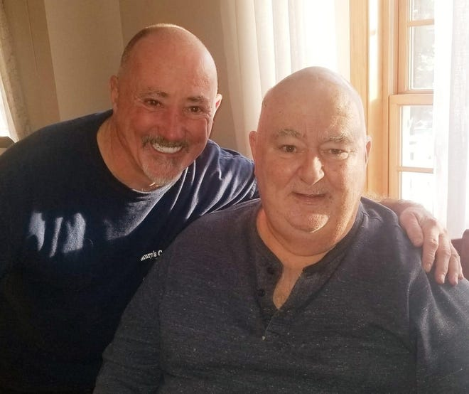 Kevin Murphy, left, shaved his head to show his support for his brother, Bill, right, who is battling brain cancer.