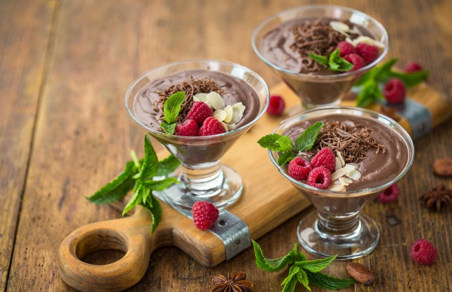 Chocolate mousse with raspberry, mint and almonds