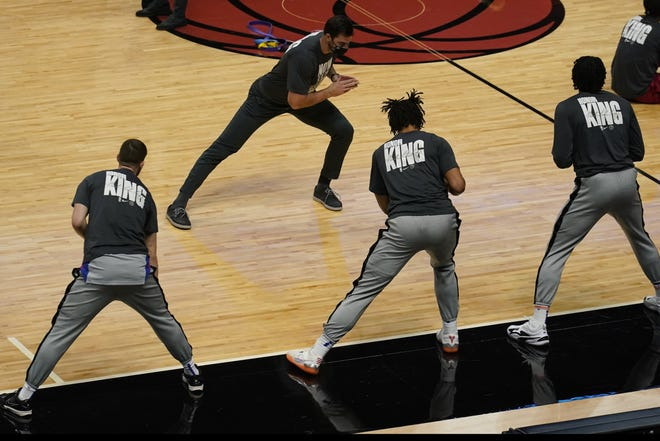 Miami Heat players wear warm up T-shirts commemorating the Martin Luther King Jr. holiday before Monday's home game against the Detroit Pistons.