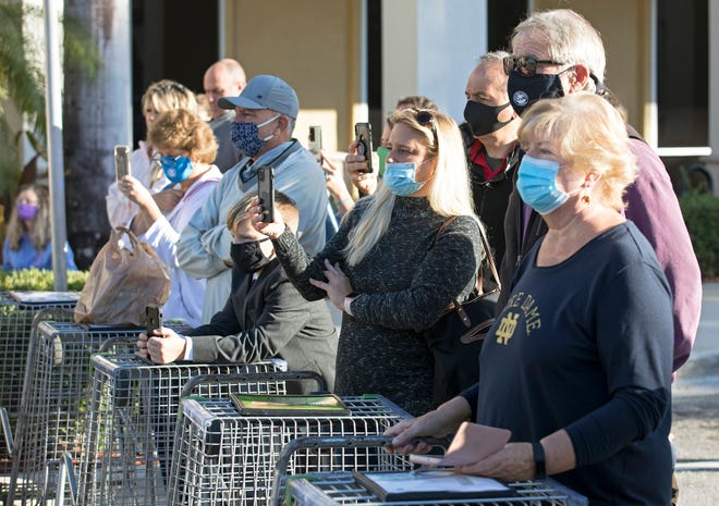 People listen as Gov. Ron DeSantis announces at a Publix in Jupiter Tuesday morning, January 19, 2021 that vaccinations against Covid-19 are coming to all all 67 Publix pharmacies in Palm Beach County. (LANNIS WATERS/PALM BEACH POST)