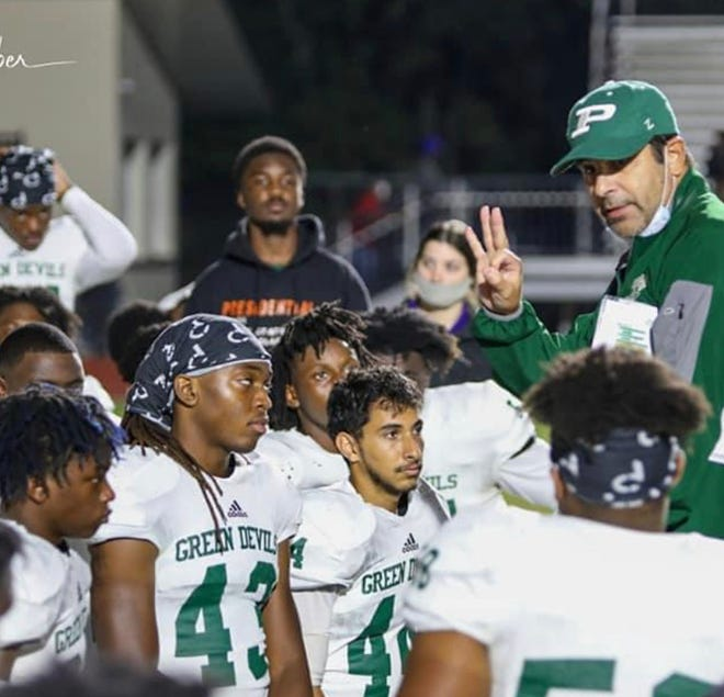 Plaquemine coach Paul Distefano is seen here with his Plaquemine Green Devils from action last season. PHS figured prominently on the All-District 7-4A roster this season.
