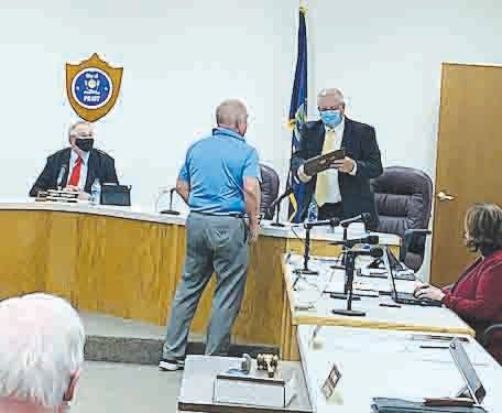 Pratt City Manager Bruce Pinkall presents outgoing Pratt city commissioner Doug Meyer with a Key to the City at his last meeting Monday.