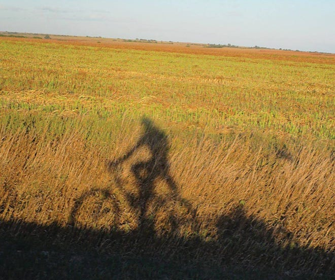 Pratt-area outdoors enthusiast and freelance columnist Brandon Case takes a picture of his shadow while cycling in Kansas recently. He has noticed an increase in dangerous meetings of cars vs. bicycles on local roads.