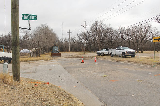 Kansas Gas Service employees put the final touches on a gas main leak fix Friday morning near the intersection of Taylor and Logan streets in Pratt after a gas leak was discovered there on Thursday evening.