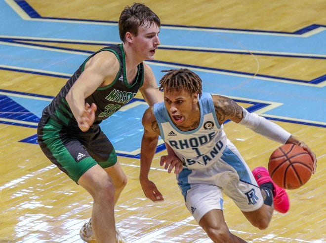 Tyler Kolek, shown guarding URI's Fatts Russell during a visit to the Ryan Center last season, will transfer from George Mason to Marquette.