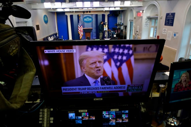 President Donald Trump is seen on a network monitor inside the press briefing room at the White House after his prerecorded farewell speech was released Tuesday afternoon.