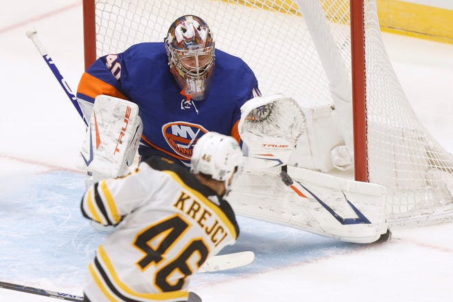 New York Islanders goalie Semyon Varlamov (40), of Russia, saves a shot from Boston Bruins' David Krejci (46), of the Czech Republic, during the second period of an NHL hockey game Monday, Jan. 18, 2021, in Uniondale, N.Y. (AP Photo/Jason DeCrow) ORG XMIT: NYJD107