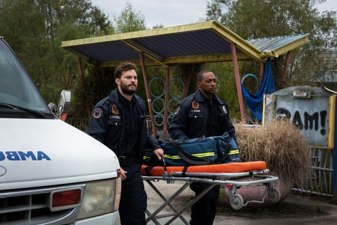 """Jamie Dornan, left, and Anthony Mackie play EMTs in New Orleans in """"Synchronic."""""""