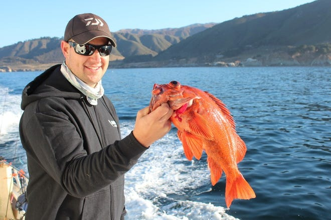 Nick Ingram of San Jose holds up a brightly colored vermilion rockfish caught on a swimbait on light tackle off the Big Sur coast aboard the Kahuna out of Moss Landing.