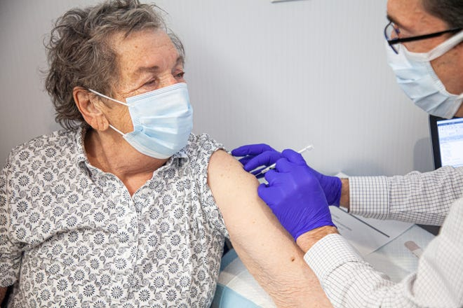 80-year-old Edna Hall of Elyria was the first patient to receive the vaccine at University Hospitals on Tuesday.