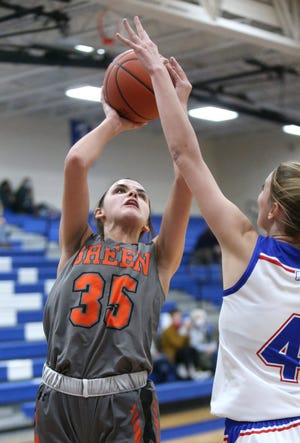 Alyssa Ziehler (35) of Green takes a shot while being guarded by Kiley Dyrlund (4) of Lake during their game at Lake on Monday, Jan. 18, 2021.