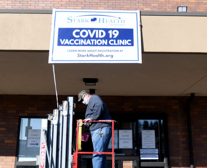 Signs were hung Tuesday at the Whipple Dale Center in preparation for Stark County Health Department's first day of vaccine clinics for people 80 and older.