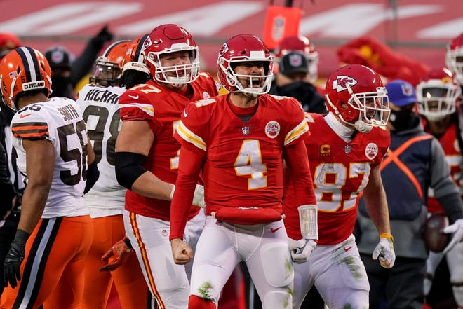 Kansas City Chiefs quarterback Chad Henne celebrates after a run during the fourth quarter of Sunday's AFC divisional round game against the Cleveland Browns in Kansas City.