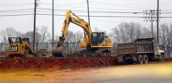 Construction crews begin clearing parking lots to make room for a new technology building at Cleveland Community College.