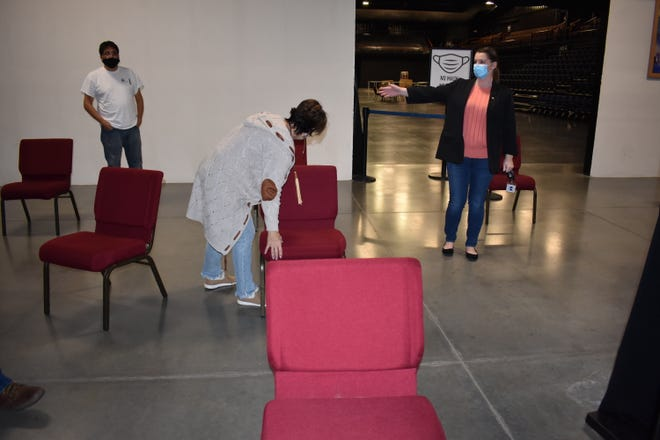 In January, Citizen Potawatomi Nation (CPN) FireLake Arena began to function as a weekly COVID-19 vaccination station. On Jan. 20, volunteers were spacing out chairs at the arena to get ready to distribute doses.