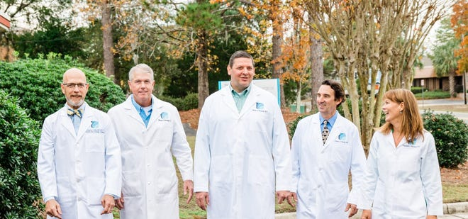 Wilmington Surgical Group: Pictured from left, Doctors Greg Bebb, Mark Medley, Mark Versnick, Jim Harris and Betsy Weinberg.