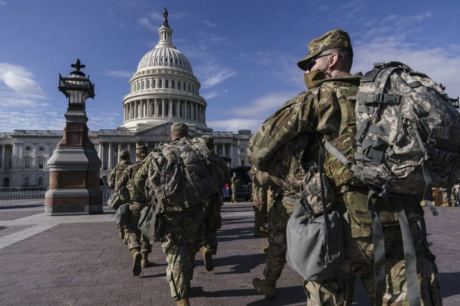 National Guard troops reinforce security around the U.S. Capitol ahead of expected protests leading up to President-elect Joe Biden's inauguration, in Washington, Sunday, Jan. 17, 2021, following the deadly attack on Congress by a mob of supporters of President Donald Trump.