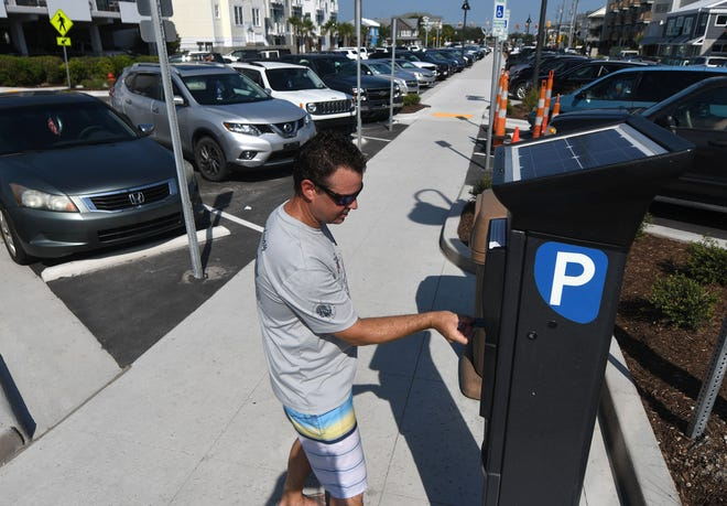 The Town of Wrightsville Beach, pictured here, has over 1,600 metered spaces available for public parking. Following a unanimous vote this week, Kure Beach will now also be enforcing paid parking.