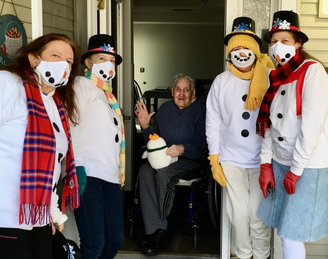 """Middleboro COA Supportive Day Program staff members, dressed as """"Snow People"""", recently visited with Day Program members, who have been unable to attend during the COVID-19 pandemic. The visits have been regular events aimed at keeping in touch with seniors who have come to look forward to and rely on the program."""