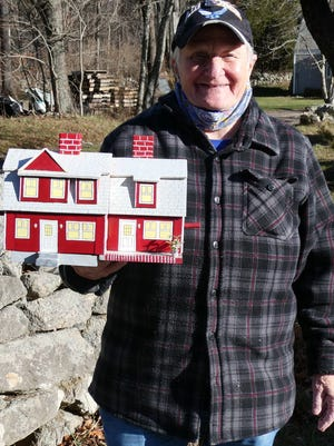 Mary Standish with her bird house replica of her sister's house at Cornerstone Farm in Rochester. Standish made use of recovery time from a recent surgery to create a number of bird houses inspired by local buildings.