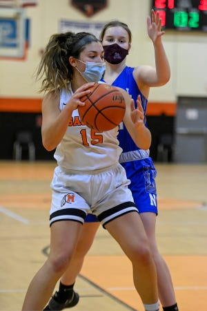 Middleboro's Mandi Bukunt works in tight quarters while being defended by Norwell's Sara Cashin during a game Jan. 12 at the Joe Masi Gym. Norwell took the win, 56-46, but the Sachems are off to a good start to the season with a 2-1 record in the first week of play.