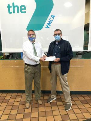 David W. Nelson is pictured presenting a check to Kelly Millington, director of Financial Development, Twin Rivers YMCA. [CONTRIBUTED PHOTO]