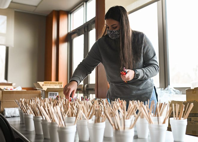 Sophia Kyriazis, an intern from Doherty High, helps put together science kits at Worcester Technical High School on Tuesday. Nearly 1,200 science kits were assembled and set to be distributed to elementary school students to use at home during at-home learning.