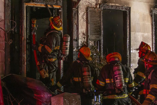 Firefighters work a fire on Oxford Street in Worcester just after midnight on Tuesday.