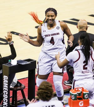 South Carolina's Aliyah Boston, a Worcester Academy graduate, is congratulated by teammates after coming out of a recent game against Arkansas, during which she posted another double-double.