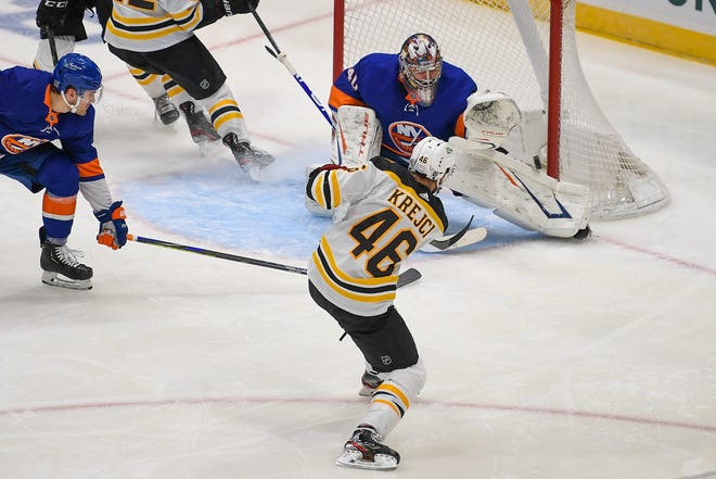 Islanders goaltender Semyon Varlamov makes a save on a shot by the Bruins' David Krejci during Monday's game in Uniondale, New York.