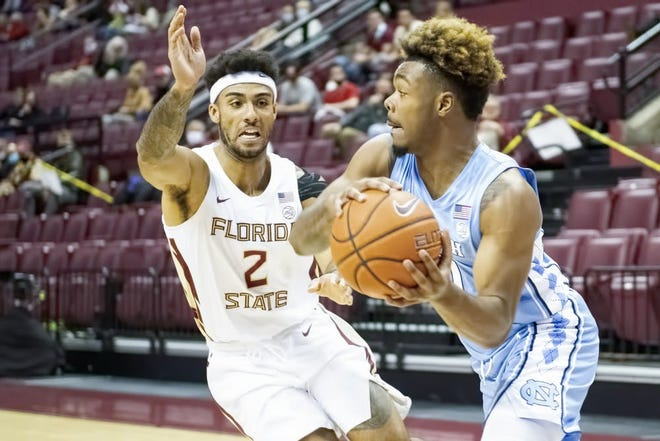 North Carolina's Anthony Harris, right, looks to make a pass as Florida State's Anthony Polite defends during Saturday's game.